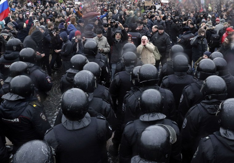 Image: Police stop protesters gathering at Dvortsovaya Square in St. Petersburg.