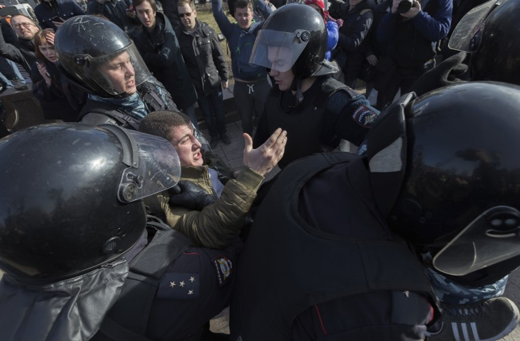 Image: Thousands of people crowded into Moscow's Pushkin Square for an unsanctioned protest against the Russian government and dozens were arrested.