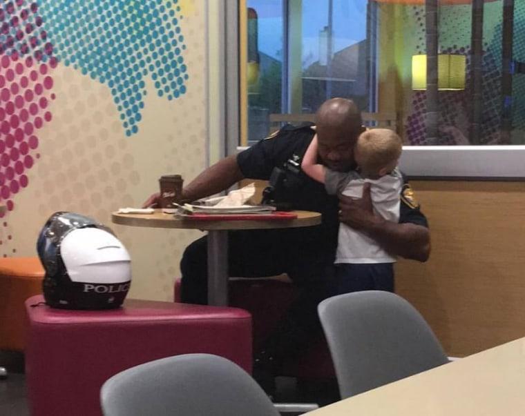 TJ hugging Officer Colter