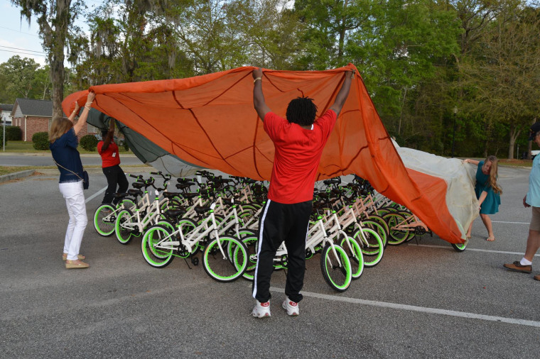 Staff at Pepperhill Elementary School in North Charleston, South Carolina, help with the big reveal.