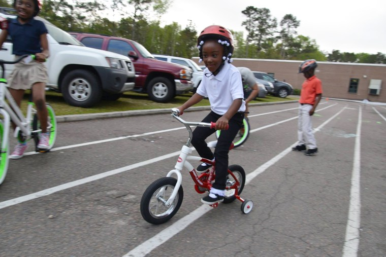 A student tries out his new set of wheels.