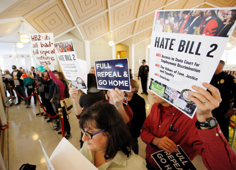Image: Opponents of North Carolina's HB2 law limiting bathroom access for transgender people protest in the gallery above the state's House of Representatives chamber as the legislature considers repealing the controversial law in Raleigh, North Carolina