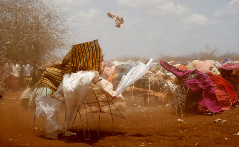 Image: A dust storm sweeps through the makeshift camp in Baidoa, March 26.