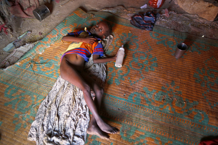 Image: A malnourished young internally displaced person with a mental disability lays inside his family's shelter in a camp on the outskirts of Qardho, in Somalia's semi-autonomous region of Puntland, March 26.
