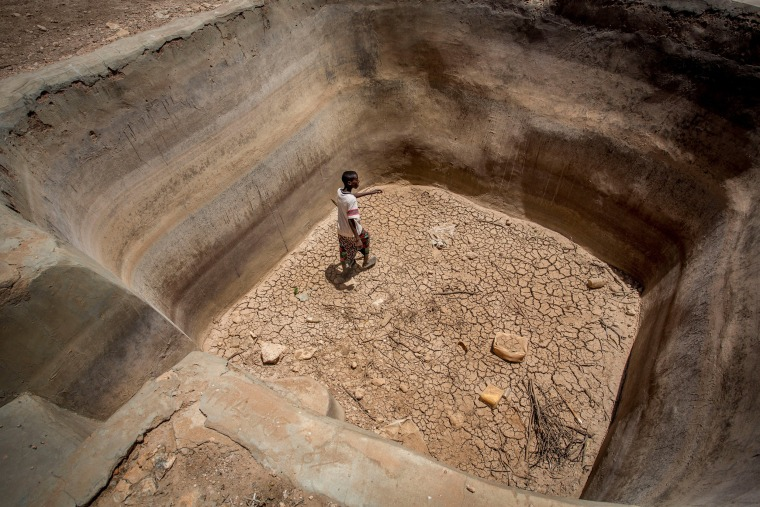 Image: A man walks in a dry underground water pan in the drought-stricken Baligubadle village in this handout picture provided by The International Federation of Red Cross and Red Crescent Societies on March 15.