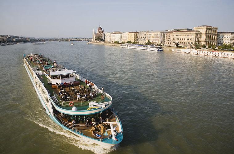 Pleasure cruise boat on the River Danube approaching Szechenyi Chain Bridge