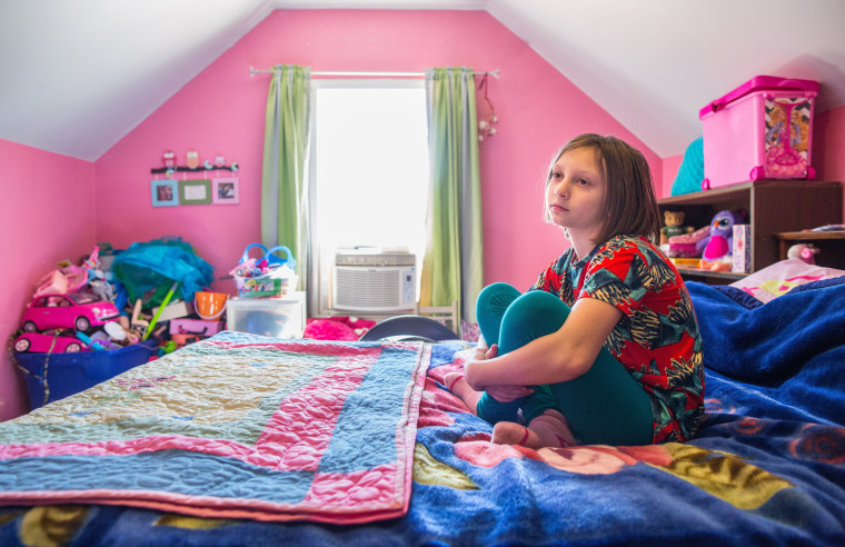 Image: Gabriella Corley sits in her room