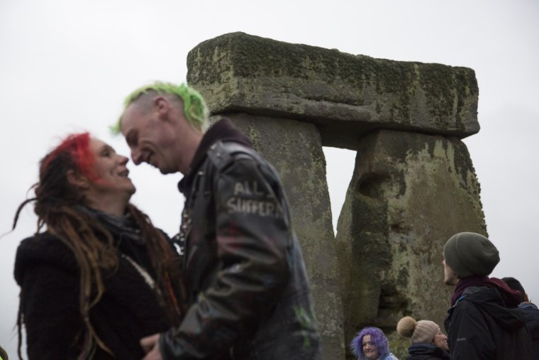 Image: A couple celebrates their symbolic marriage at Stonehenge