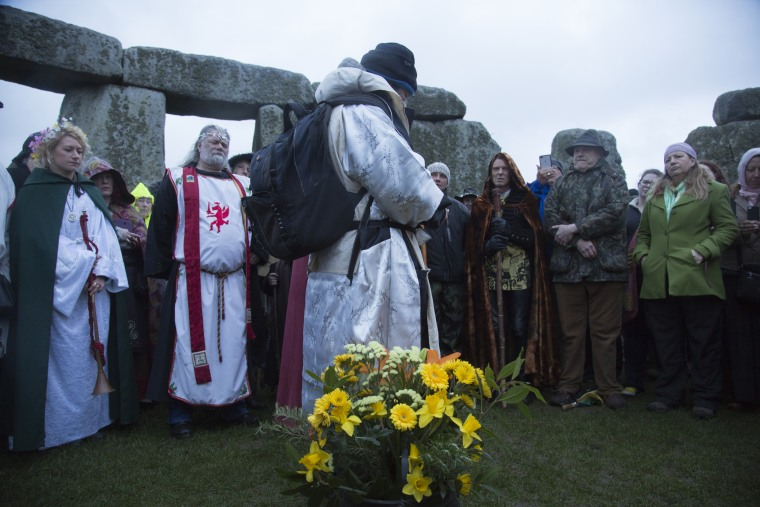 Image: Druids and tourists at Stonehenge on March 20, 2017