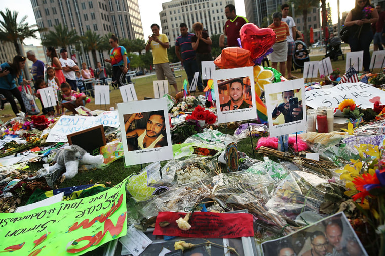 People visit a memorial in Orlando, Florida, for those killed at the Pulse nightclub.