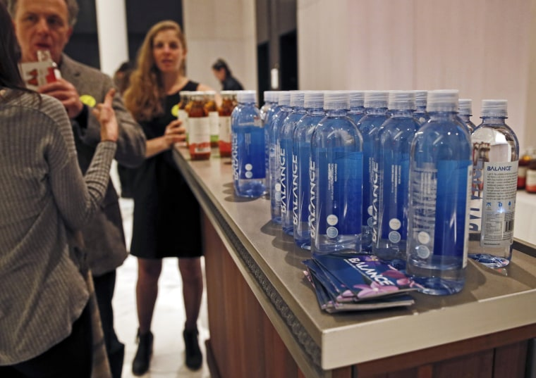 Image: Bottles of water and flavored tea are displayed during The Shine, an alcohol-free social social event at a chic hotel in Williamsburg, Brooklyn on March 8, 2017.