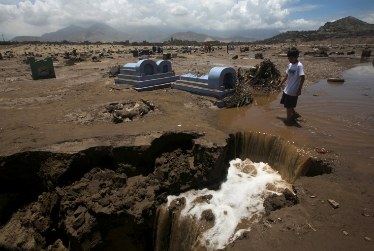 Image: View of a damaged cemetery after rainfall and flood in Trujillo, northern Peru