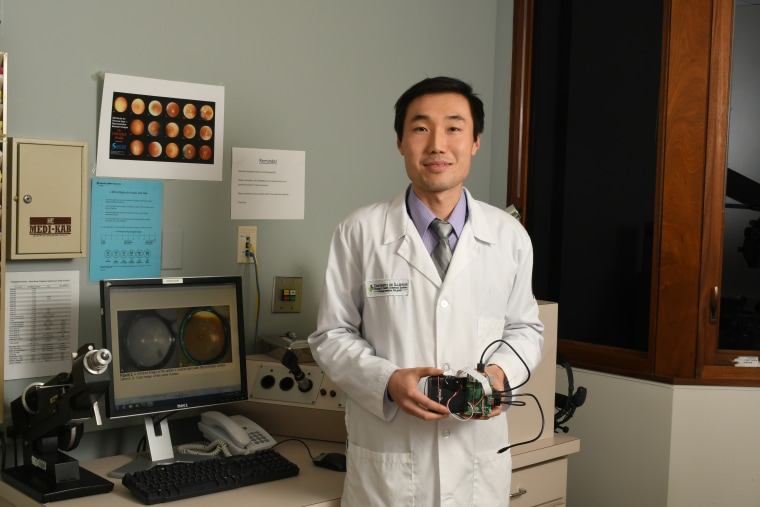 Dr. Bailey Shen holds his new prototype, which weighs less than a pound.