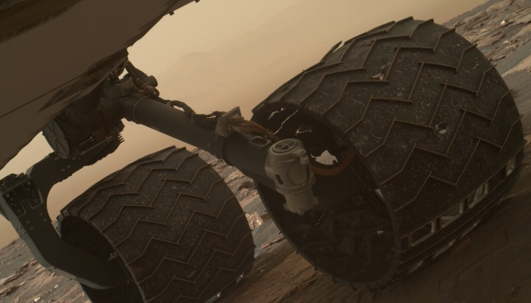 Two small breaks on the Curiosity rover's left middle wheel were discovered during a routine check, using the Mars Hand Lens Imager camera.