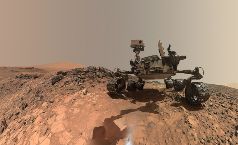 This self-portrait of the Mars Curiosity rover reveals a rock stuck to the left middle wheel.