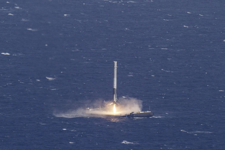 Image: Handout photo of the reusable main-stage booster from the SpaceX Falcon 9 makes a successful landing on a platform in the Atlantic Ocean about 185 Nautical miles off the coast of Florida