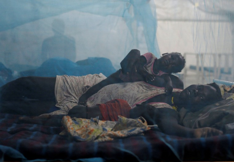 Image: A woman rests in bed with her children in the paediatric ward at the Medecins Sans Frontieres (MSF) hospital inside the UNMISS base in Bentiu, Rubkona County