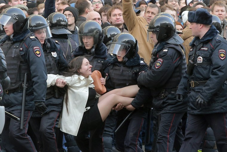 Image: Russian riot policemen detain a demonstrator during an opposition rally in central Moscow, Russia on March 26, 2017