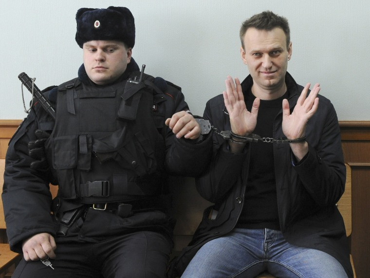 Image: Russian opposition leader Alexei Navalny, right, poses for press in court in Moscow, Russia on March 30, 2017
