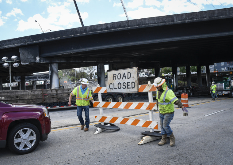 Image: Workers close off a street going under I-85 interstate