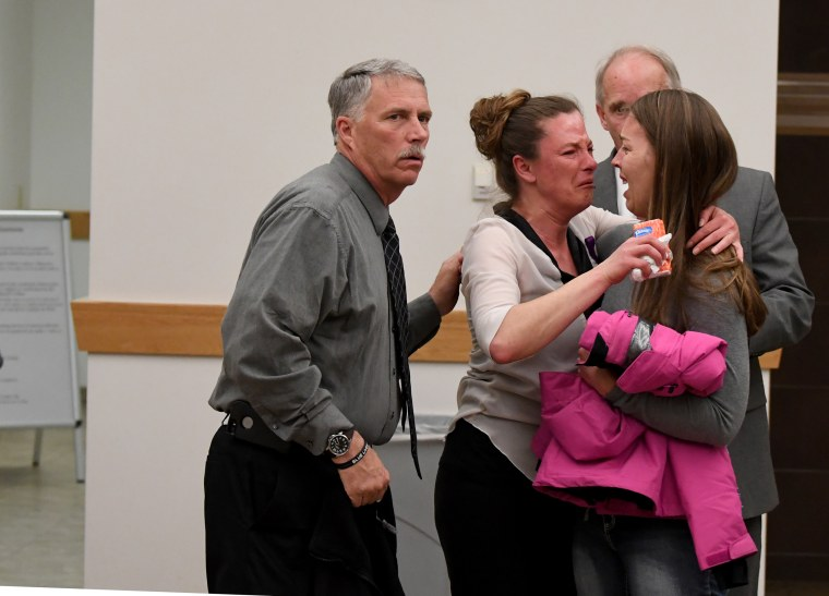 Image: Friends and family of Tina Tournai Sandoval come out of a courtroom after her estranged husband John Sandoval pleaded guilty to killing her on March 31, 2017 in Greeley, Colorado.