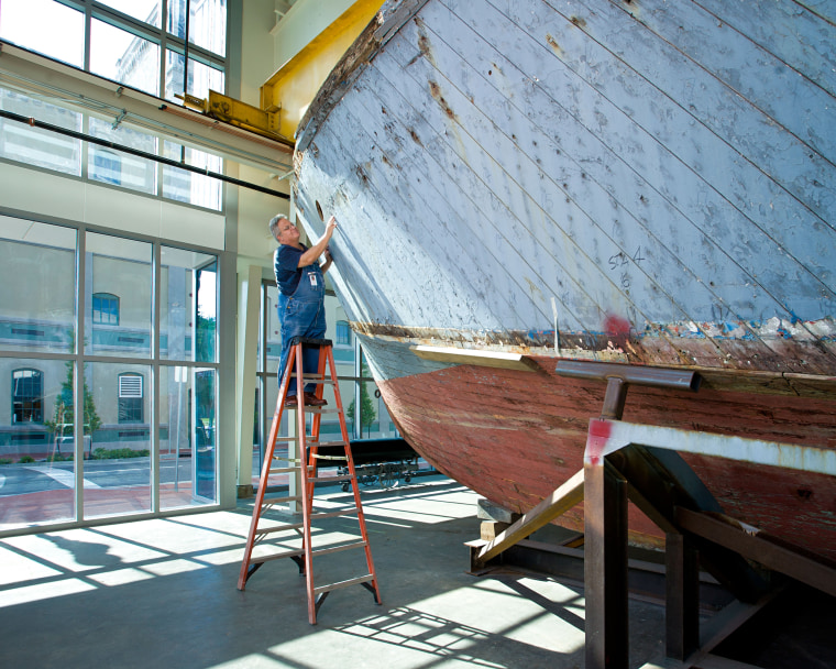 Image: Thomas Czekanski, the Museum's senior curator and restorations manager, with PT-305 shortly after her 2007 return to New Orleans.