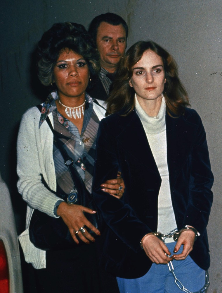 Patricia Hearst led in shackles into court in San Francisco in 1976.