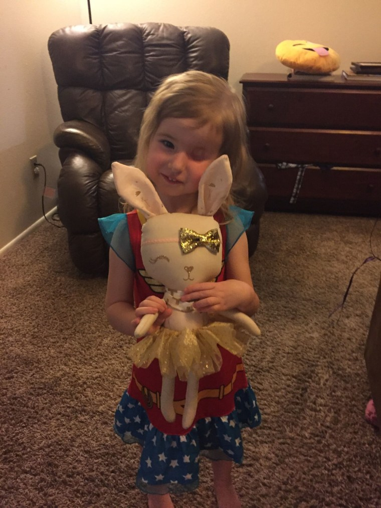 Brynn smiling with her new lookalike bunny, Sparkle, which she received for her third birthday.