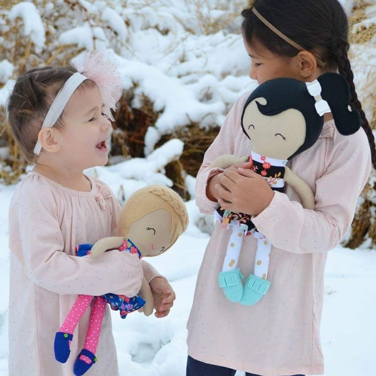 The doll maker's daughters with their custom dolls: Pemberly, 3, and Ellie 6.
