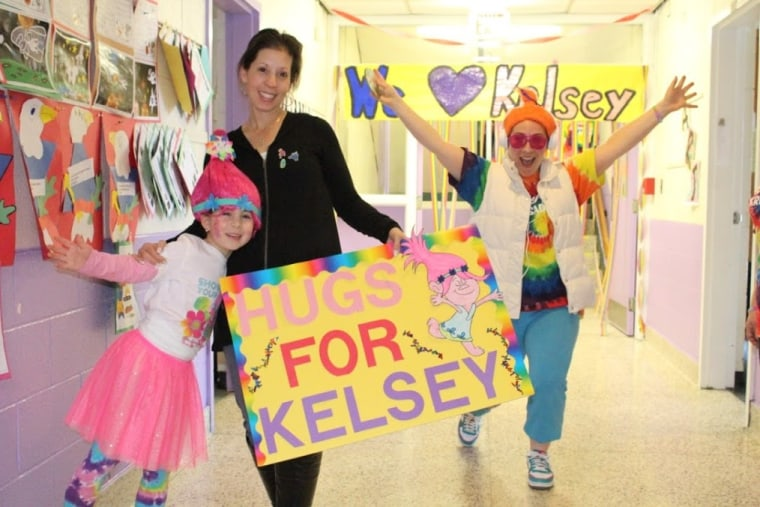 Student Alexa Doran with her mom, Laura Doran, and Kristen Covert, a first grade teacher at the school.