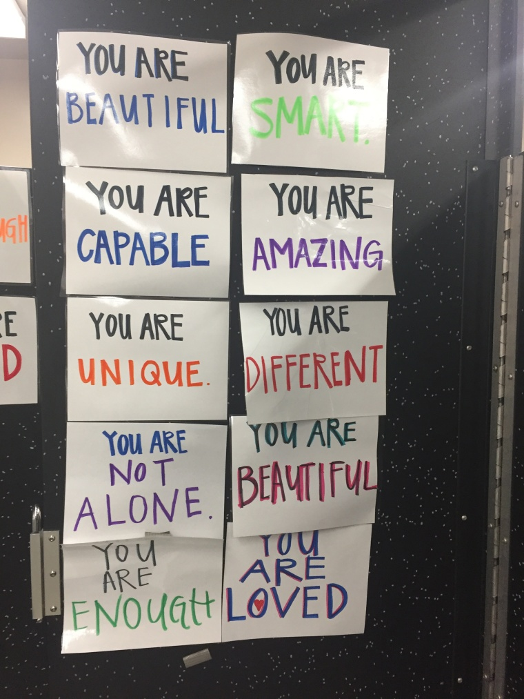 """Chelsea Maxwell, the school's activity director, told TODAY the signs were """"meant to brighten our students' days and remind them that they are enough."""""""