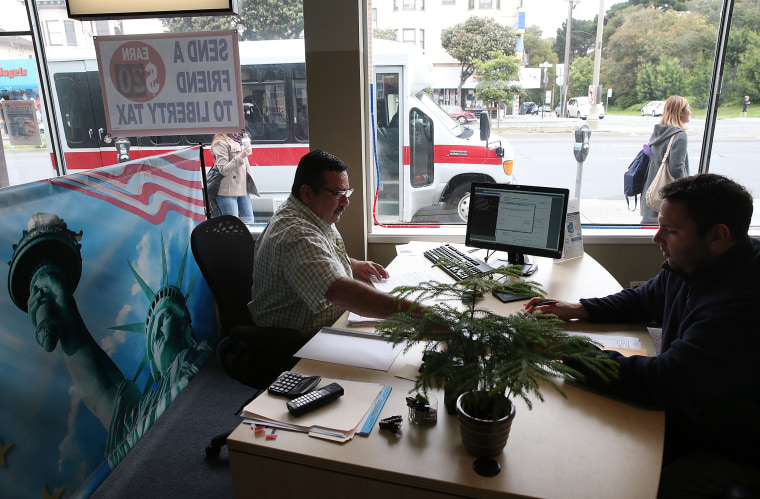 Image: A tax preparer helps a customer in San Francisco