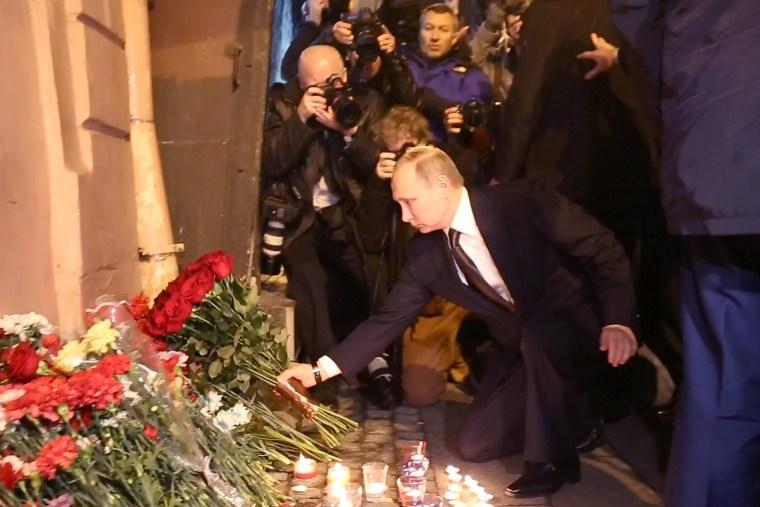 Image: Vladimir Putin lays flowers at the scene of the St. Petersburg subway attack