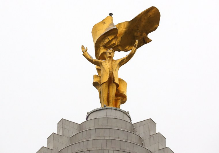 Image: A 12-metre tall gold-plated statue of the first Turkmen president Saparmurat Niyazo
