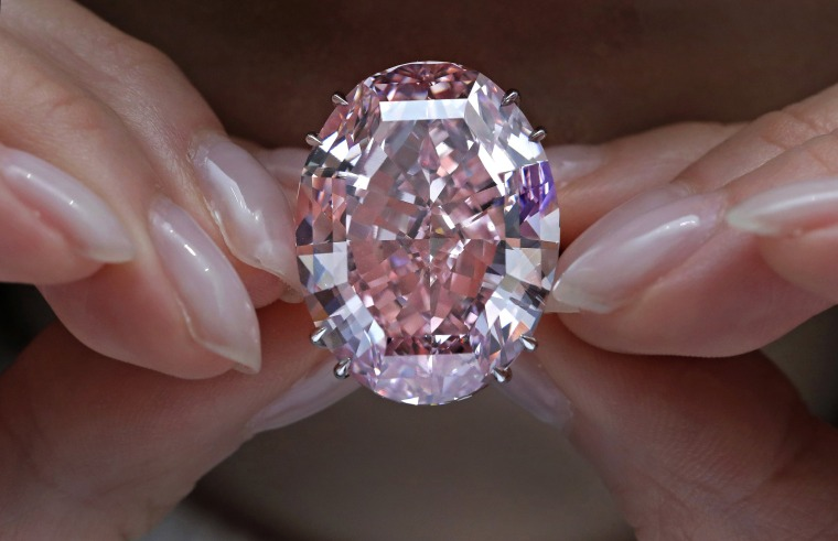 Image: A model displays the Pink Star diamond, the most valuable cut diamond ever offered at auction, at a Sotheby's auction room in Hong Kong, on March 29, 2017