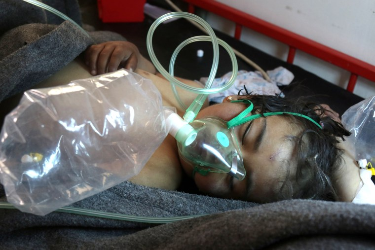 Image: A Syrian child receives treatment at a small hospital in the town of Maaret al-Noman following a suspected toxic gas attack