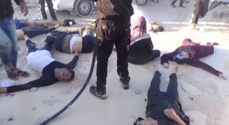 Image: A still image taken from a video posted to a social media website on April 4, 2017, shows people lying on the ground, said to be in the town of Khan Sheikhoun, after what rescue workers described as a suspected gas attack in rebel-held Idlib
