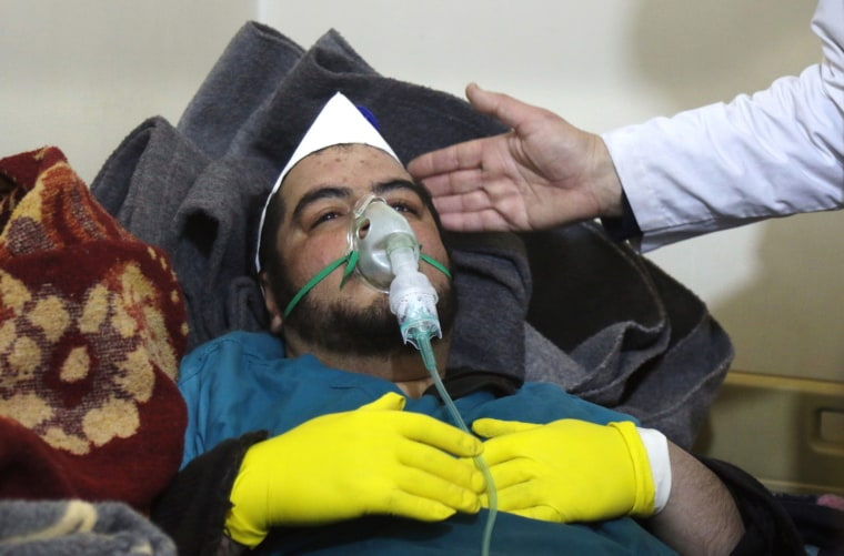 Image: A Syrian man receives treatment at a small hospital in the town of Maaret al-Noman