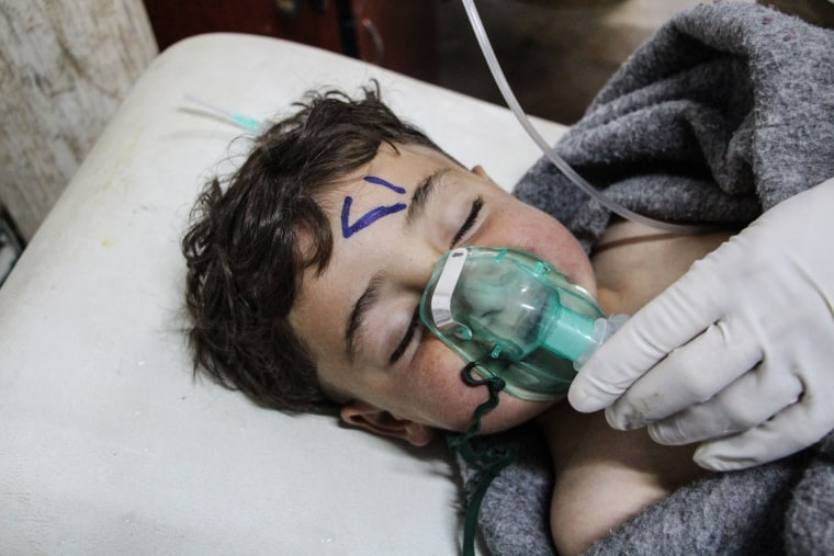 Image: At least 58 killed in suspected gas attack in northern Syria, NGO