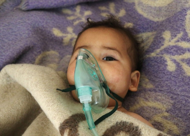 Image: A Syrian child receives treatment at a small hospital in the town of Maaret al-Noman