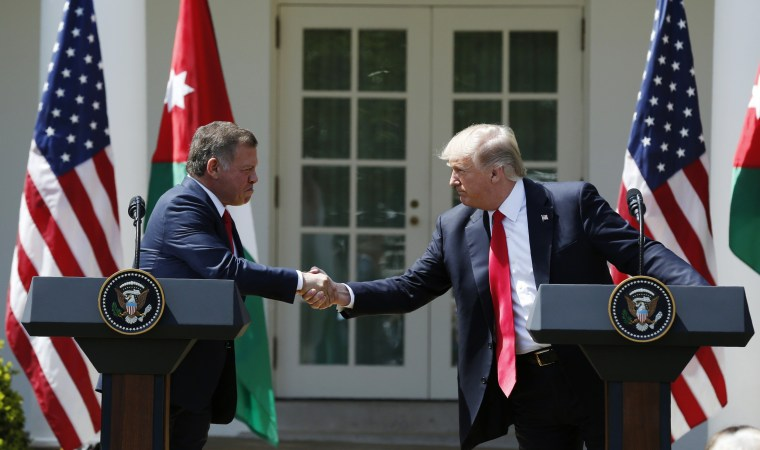 Image: U.S. President Trump greets Jordan's King Abdullah II during joint news conference at the White House in Washington