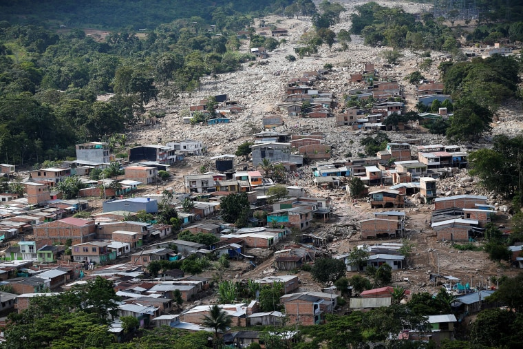 Image: Aerial view of a neighborhood destroyed after flooding and mudslides caused by heavy rains leading several rivers to overflow, pushing sediment and rocks into buildings and roads, in Mocoa