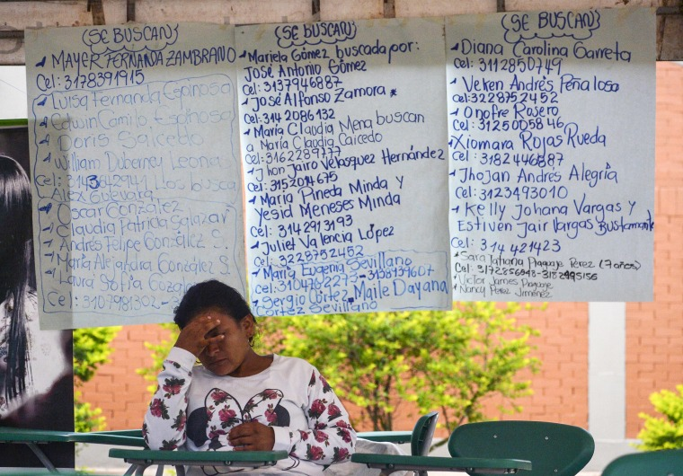 Image: A woman waits for news of her missing relatives at a shelter in Mocoa