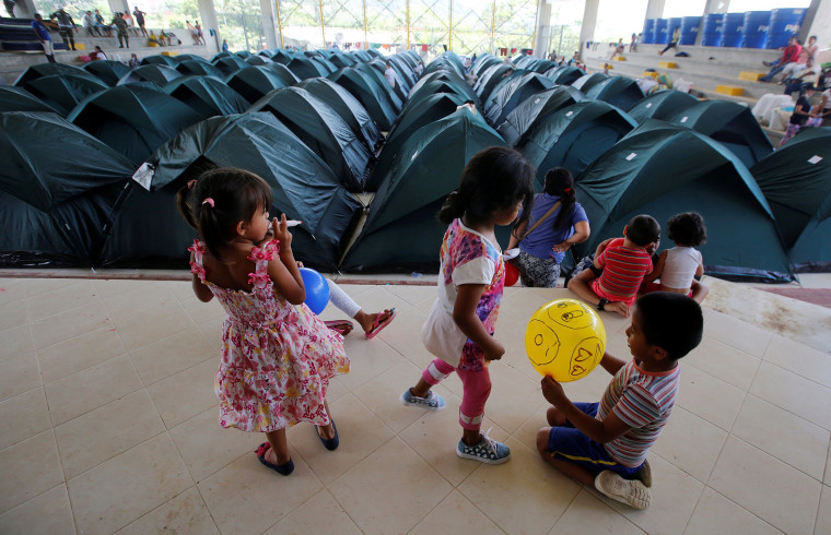 Image: Children play in a shelter for people who became homeless after flooding and mudslides caused by heavy rains leading several rivers to overflow, pushing sediment and rocks into buildings and roads in Mocoa