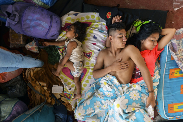 Image: A family rests at a shelter in Mocoa