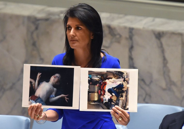 Image: Nikki Haley held photos of victims as she spoke at an U.N session on the suspected gas attack.