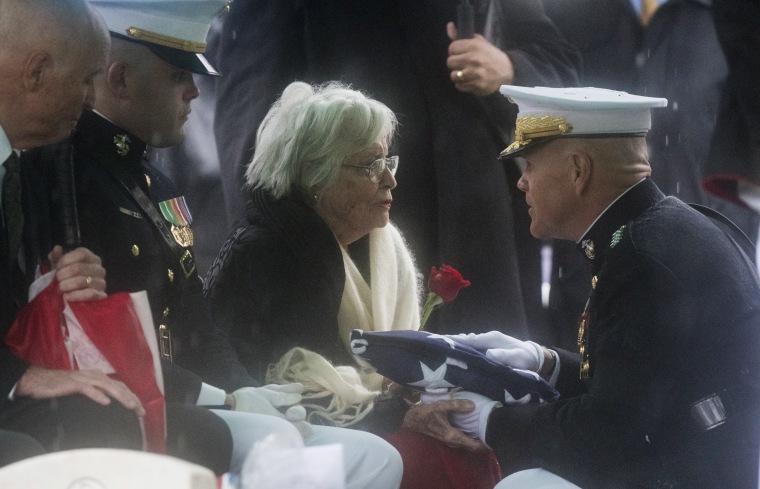 Image: Annie Glenn receives a flag at the funeral for husband John Glenn