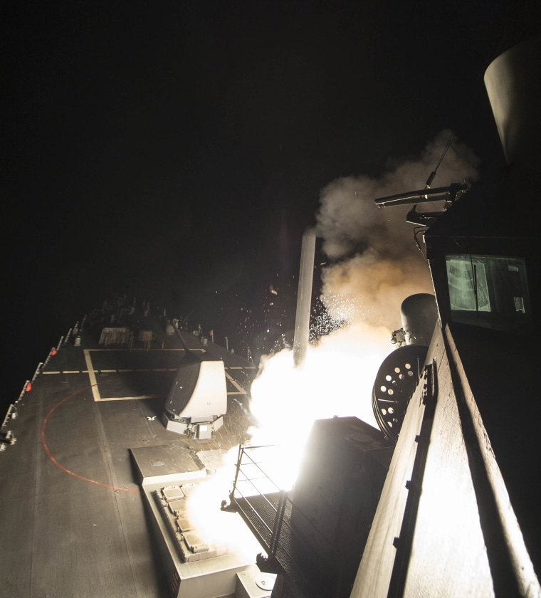 Image: The USS Ross fires a tomahawk land attack missile