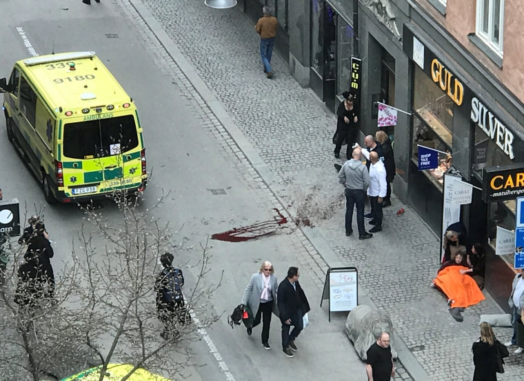 Image: Ambulance in a street near the site were a truck was driving into a crowd in central Stockholm