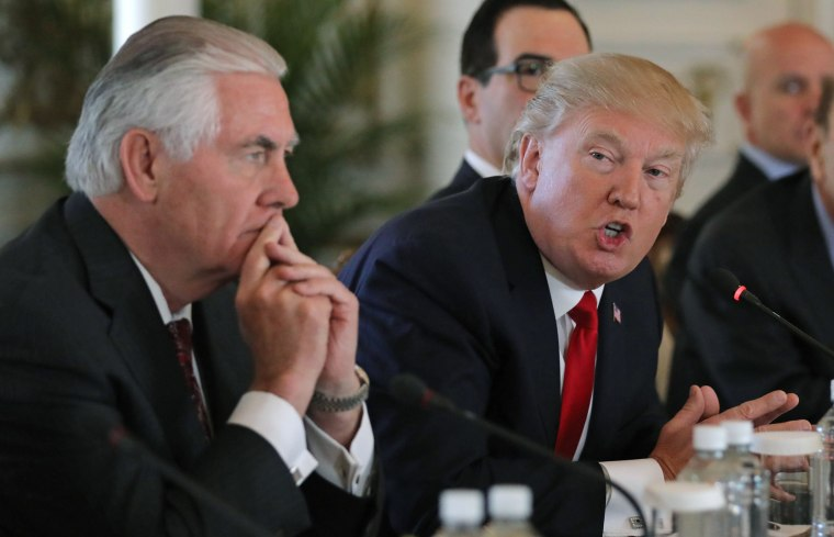 Image: U.S. President Trump speaks next to Tillerson during bilateral meeting with China's President Xi at Trump's Mar-a-Lago estate in Palm Beach